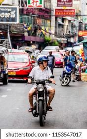 Bangkok, Thailand - 2018, July 29 : The man who riding motercycle on the China town, Bangkok, Thailand.