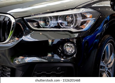 Bangkok , Thailand 2019 : close up headlight front view of BMW X1 sDrive20d M Sport luxury car presented in motor show Thailand .