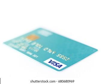 BANGKOK, THAILAND - 21 JULY 2017: Closeup studio shot of credit cards issued by the three major brands American Express, VISA and MasterCard.