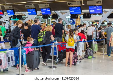 BANGKOK, THAILAND - 21 JULY 2018 - Tourists wait in line to check their luggages in at the airport airline check in counters of Suvarnaphumi International Airport in Bangkok, Thailand on July 21, 201
