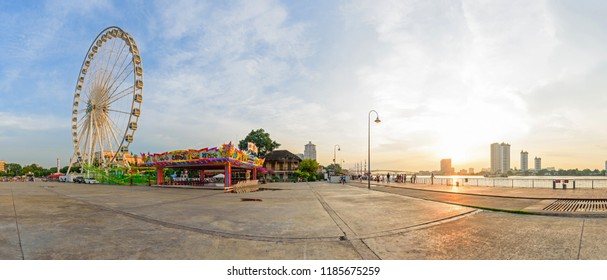 Bangkok , Thailand - 21 Sep, 2018: Panorama view Ferris wheel in amusement park at  ASIATIQUE The Riverfront Shopping park / Sunset time at Ferris wheel in amusement park