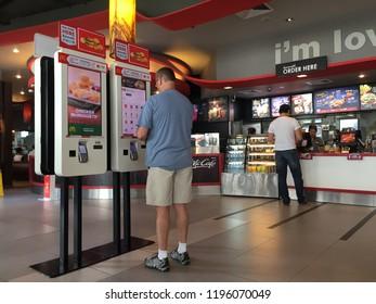 Bangkok, Thailand: 22 September 2018, The customer ordering burger at the self service machine in McDonald's