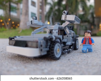 Bangkok, Thailand: 23 April 2017 - Lego Marty McFly walking to his DeLorean time machine parking in the garden. This set is from Back to the Future movie.