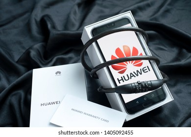 Bangkok, Thailand - 23 May 2019: Huawei phones with decoders With box and warranty, Huawei security issues, business crisis, Huawei logo screen