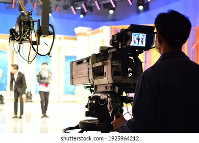 Bangkok, THAILAND - 24 February 2021 : A cameraman's back view with a high quality television camera in television production.