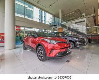 Bangkok, Thailand, 24/8/2019, C-HR in red, parked in the center for customers who are interested to see the Toyota brand cars Toyota was established in 1936