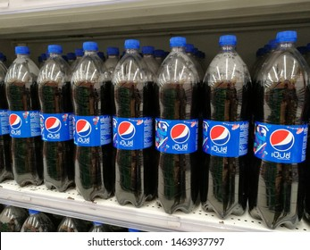 Bangkok, Thailand- 24th May 2019: Close up shot of two rows of Pepsi carbonated drinks on a Bangkok supermarket shelf. Pepsi is a carbonated soft drink produced and manufactured by Pepsi.Co