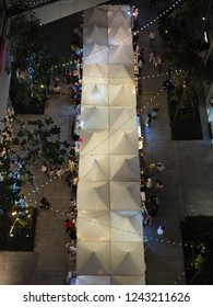Bangkok, Thailand. 24th November 2018. Aerial view of Emquatier outdoor shops at night with fews people.