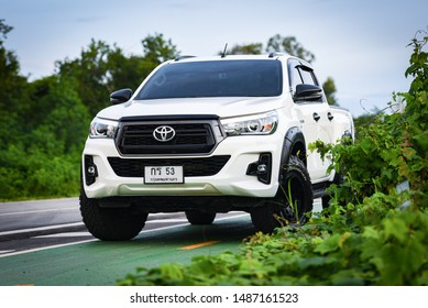 Bangkok Thailand - 25 August 2019 : New Toyota Hilux Revo Rocco white Pickup  Truck Offroad Car double cab 4x4 On the road car brand from Japan based