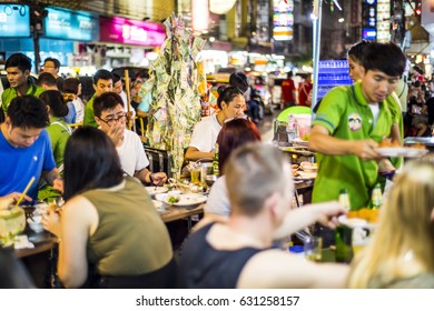 Bangkok, Thailand - 25 February, 2017: Many people eating street food on the lively Yarowat Road, also known as Chinatown