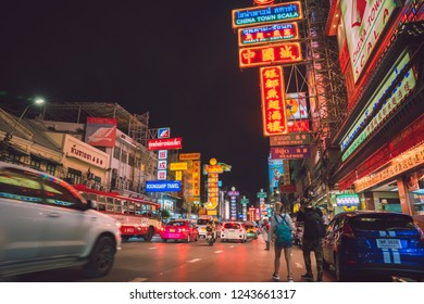 Bangkok, Thailand 25 NOV, 2018 : People and Cars with  street food shops on Yaowarat road, the main street of Bangkok China town.Chinatown is one of the famous landmark in Bangkok.