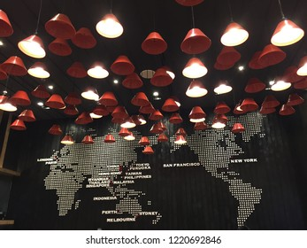 Bangkok, Thailand : 25 October, 2018 - Red lamps hang from the ceiling in the global map black background in the cafe