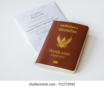 Bangkok , Thailand 26 July 2017 , Thai Passport and International driving license on the white background, necessary documents for oversea business trip