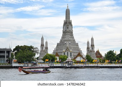 "Bangkok / THAILAND - 26 July 2019 : Wat Arun Ratchawararam is known as the short name ""Wat Arun"" or ""Wat Chaeng"". One of the highlight tourist attractions in Thailand."