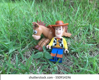 Bangkok, Thailand: 26 Sep 2016 - Lego Woody and Bullseye relaxing on the grass field. These mini figures are from Toy Story sets. Lego is a brick brand by Lego group