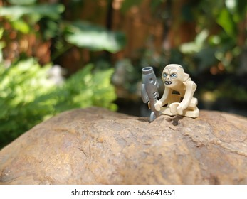 Bangkok, Thailand: 27 Jan 2017 - Lego Gollum holding a fish near the pond. This mini figure is from The Lord of The Ring sets. Lego is a brick brand by Lego group.