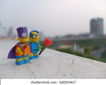 Bangkok, Thailand: 29 April 2017 - Lego Bart Simpson and Millhouse being Bartman and Fallout Boy for the US national superhero day. These minifigures are from Lego the simpsons series 2.