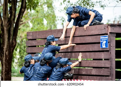 Bangkok Thailand 29 Mar 2017 : The air force nurse student were pushing and pulling their friends to climb pass the barrier in projectX military training of air force .