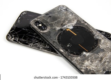 Bangkok, Thailand, 29 May 2020, iphone x broken glass on the front and back of the phone close up on a white background
