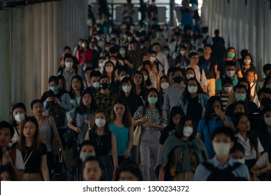 BANGKOK THAILAND, 30 Jan 2019 :Group of many salary man wearing face mask for protect micro dust in air while going to their workplace during pm2.5  air pollution crisis in Bangkok at moring rush hour