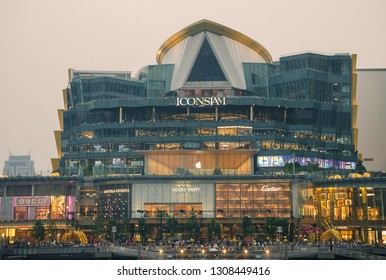 BANGKOK, THAILAND - 30 Jan, 2019: Exterior view of Iconsiam at River side. ICON SIAM is the new Shopping Center and Landmark of Bangkok at evening with motion blur of many tourist in front.