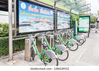 Bangkok, Thailand - 31st March 2018: Bicycles lined up on Sukhumvit Road. They belong to the Pun Pun bike sharing scheme.