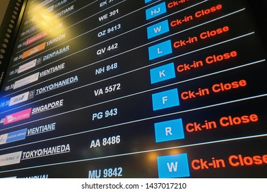 BANGKOK, THAILAND - 5 APR 2019: Close up airport flight connection information board. selective focus on Check in Close word, punctuality concept.