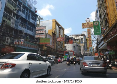 BANGKOK, THAILAND - 5 APR 2019: View of cars and shops on Yaowarat road. Chinatown with notable Chinese buildings, restaurants and decoration. Busy Yaowarat Road, Bangkok, Thailand