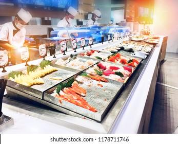 Bangkok, Thailand - 5 AUG 2018 : A lot of Sushi buffet.  Japanese buffet restaurant sushi bar in Bangkok, Thailand. People self serving flavored Japan fare, plus noodle & hibachi stations dishes.