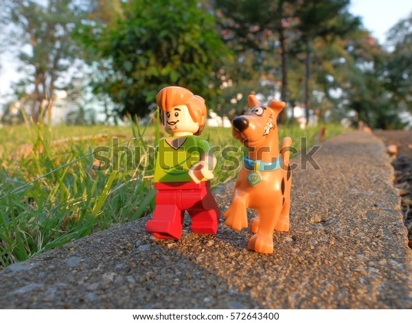 Bangkok, Thailand: 5 Feb 2017 - Lego Shaggy and Scooby Doo going for a walk in the park. These mini figures are from Scooby-do sets. Lego is a brick brand by Lego group.