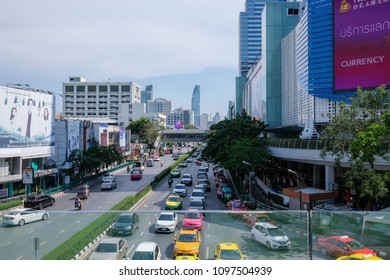 Bangkok, Thailand - 5 May 2018: Siam Discover Department Store with BTS Sky Train in Clear Blue Sky Day.