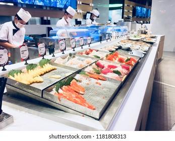 Bangkok, Thailand - 5 MAY 2018 : A lot of Sushi buffet.  Japanese buffet restaurant sushi bar in Bangkok, Thailand. People self serving flavored Japan fare, plus noodle & hibachi stations dishes.