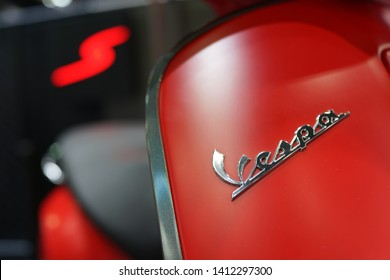 BANGKOK, THAILAND - 6 APR 2019: Close up elegantly designed of vespa scooter logo display in exhibition hall. Vespa is an Italian brand of scooter manufactured by Piaggio.