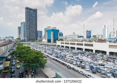 Bangkok, Thailand - 6 April, 2019 : Rows of Cars and Vehicle in Public parking Lots in Bangkok, Thailand.  Amount of Cars in Bangkok keep increasing in 2019.