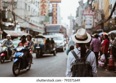 Bangkok, Thailand, 6 January 2018: Young Woman traveling backpacker, Asian traveler standing in China town or Yaowarat street, Bangkok