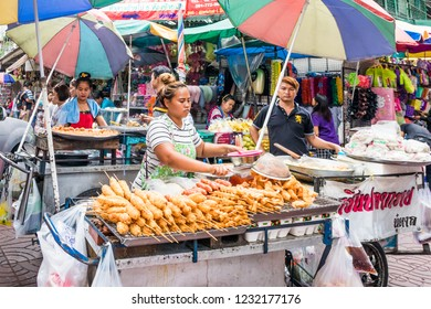 Bangkok, Thailand - 6th October 2018: Street vendors selling various food. There are still many mobile street vendors in the city.