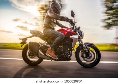 Bangkok, Thailand - 8 March 2018 : Motorcyclist ride Honda CB300R on the road in sunset time