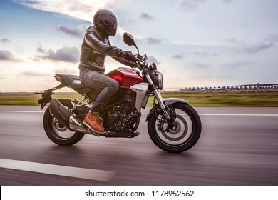 Bangkok, Thailand - 8 March 2018 : Biker ride Honda CB300R on the road in sunset