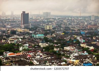 BANGKOK, THAILAND - Apr 12, 2013: On horizon in haze you can see city center, and in foreground suburbs Bangkok