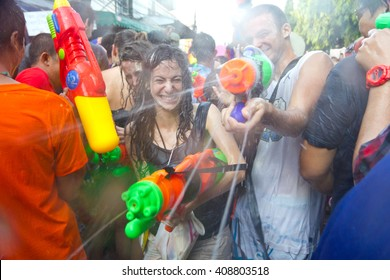 Bangkok, Thailand - APR 13, 2012: Songkran Festival in Khao San Road. A moment of Thai poeple and foreigner celebrate this famous event together. These photos are taken by camera in a water-proof bag.
