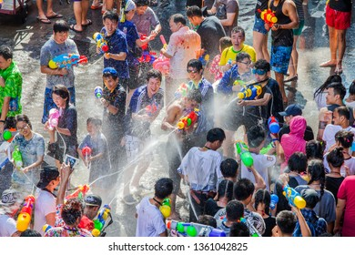 BANGKOK, THAILAND - APR 13: Famous Songkran Festival in Silom on April 13, 2018. One of the most popular water fight places during Songkran in Bangkok, Thailand.