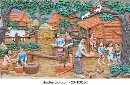 BANGKOK ,THAILAND - APR 14 : Stone carving of Traditional Thai culture on temple wall at Wat Dan on April 14, 2013 in Bangkok, Thailand.