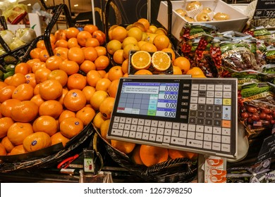 Bangkok, Thailand - Apr 20, 2018. Fresh orange on the shelf with electronic scale in the fresh fruit zone at supermarket in Bangkok, Thailand.