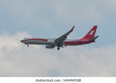 Bangkok, Thailand - Apr 21, 2018. B-1512 Shanghai Airlines Boeing 737-800 landing at Bangkok Suvarnabhumi International Airport (BKK).