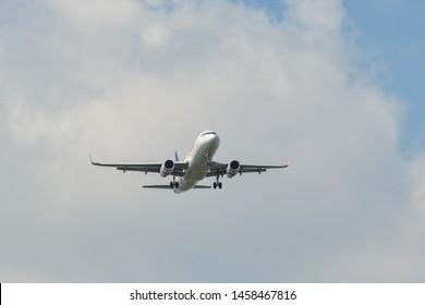 Bangkok, Thailand - Apr 21, 2018. Thai Smile Airbus A320 landing at Bangkok Suvarnabhumi International Airport (BKK).