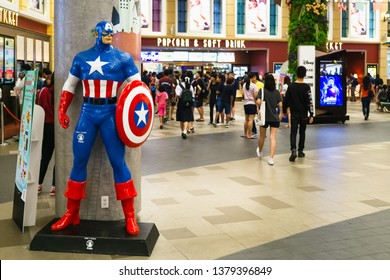 Bangkok, Thailand - Apr 24, 2019: Avengers 4 Endgame character model Captain America in front of the Theatre with People queing up to buy tickets at cinema to see the Avengers Endgame.