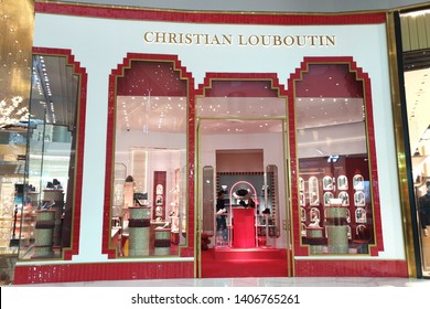 BANGKOK, THAILAND - APR 5, 2019: Christian Louboutin luxury boutique store in ICONSIAM Mall. It is a French luxury footwear and fashion designer whose footwear has incorporated shiny heels.