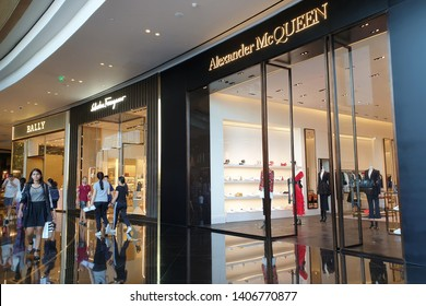 BANGKOK, THAILAND - APR 5, 2019: Alexander McQueen luxury boutique store in ICONSIAM Mall. Lee Alexander McQueen was a British fashion designer with in-depth knowledge of tailoring.