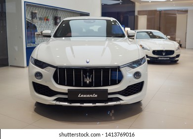 BANGKOK, THAILAND - APR 5, 2019: White Maserati levante on display in ICONSIAM Mall. Maserati is an Italian luxury vehicle manufacturer focus on luxury, sports and style cast in exclusive cars.