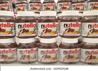BANGKOK, THAILAND - APR 7, 2019 : Row of Nutella hazelnut spread on store shelves. Nutella is the brand name of a sweetened hazelnut cocoa spread. Manufactured by the Italian company Ferrero.